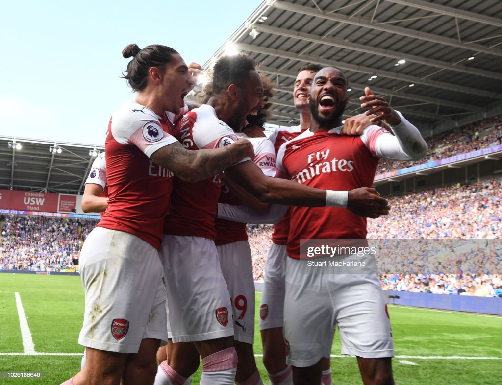Pierre-Emerick Aubameyang celebrates the 2nd goal with (L) Hector Bellerin and (R) Alex Lacazette during the Premier League match between Cardiff City and Arsenal at Cardiff City Stadium on September 2, 2018 in Cardiff, United Kingdom.