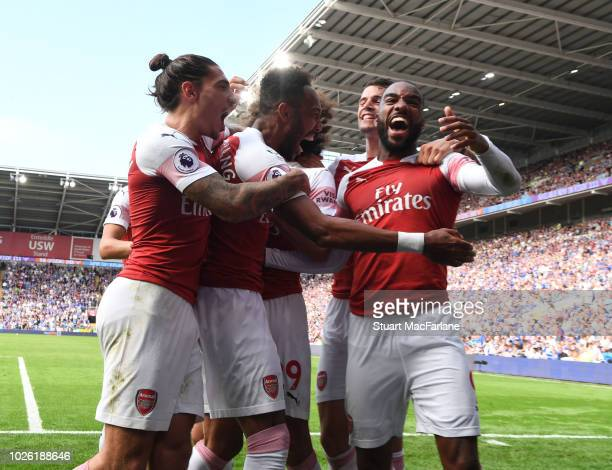 PierreEmerick Aubameyang celebrates the 2nd goal with Hector Bellerin and Alex Lacazette during the Premier League match between Cardiff City and...
