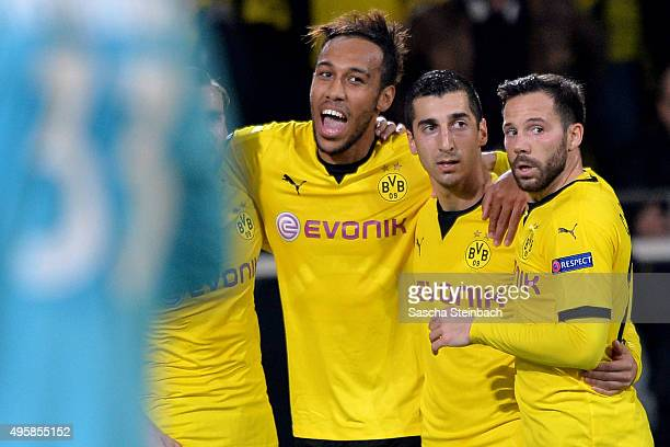 PierreEmerick Aubameyang celebrates with team mates Henrikh Mkhitaryan and Gonzalo Castro of Dortmund after scoring his team's second goal during the...