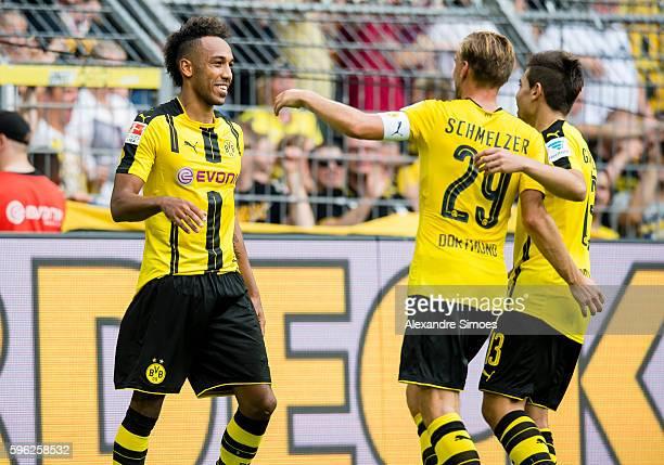 PierreEmerick Aubameyang cheers after scoring his team's 2nd goal during the Bundesliga match between Borussia Dortmund and 1 FSV Mainz 05 at Signal...