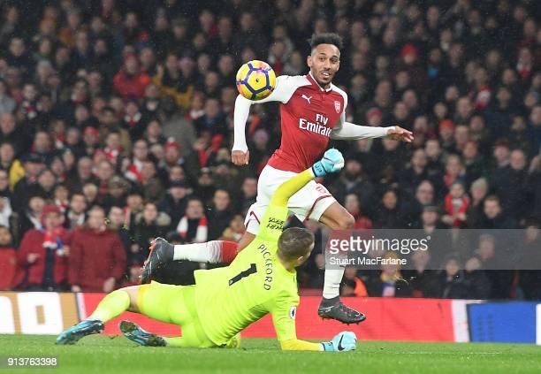 PierreEmerick Aubameyang chips the ball over Everton goalkeeper Jordan Pickford to score the 4th Arsenal goal during the Premier League match between...
