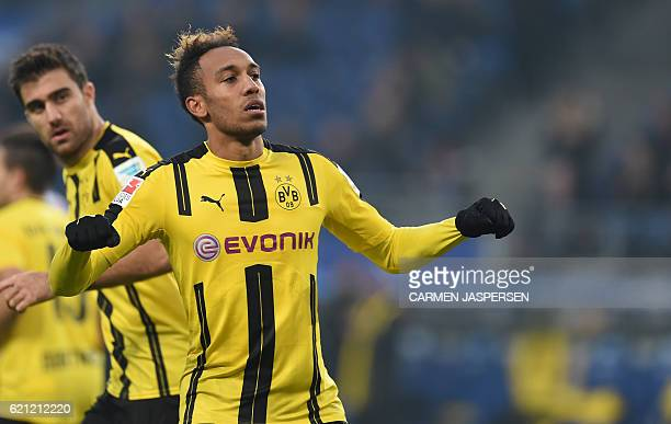 PierreEmerick Aubameyang from Dortmund celebrates his fourth goal to the 04 during the German first division Bundesliga football match between...