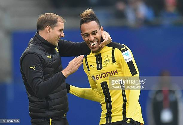 PierreEmerick Aubameyang from Dortmund celebrateS with coach Thomas Tuchel his goal during the German first division Bundesliga football match...