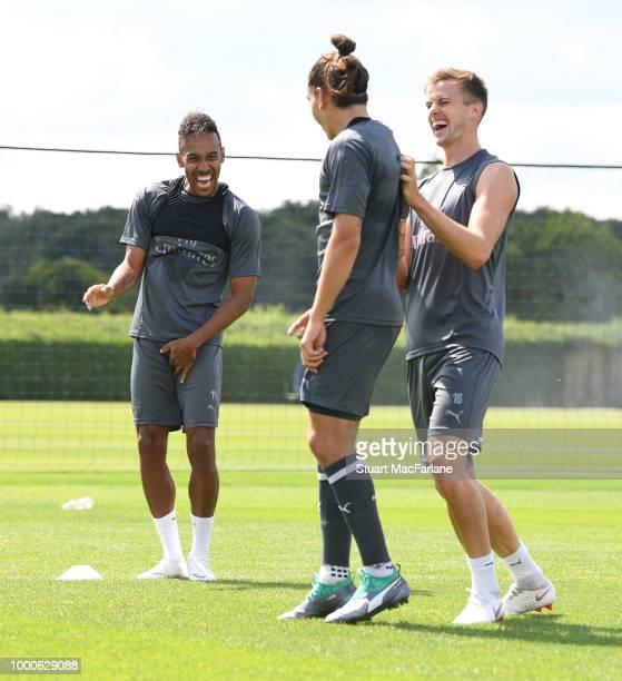 PierreEmerick Aubameyang Hector Bellerin and Rob Holding of Arsenal during a training session at London Colney on July 17 2018 in St Albans England