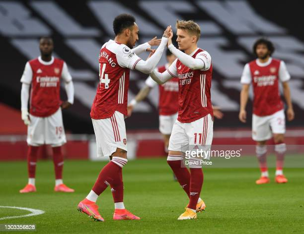 Pierre-Emerick Aubameyang high fives of Martin Odegaard of Arsenal before the Premier League match between Arsenal and Manchester City at Emirates...