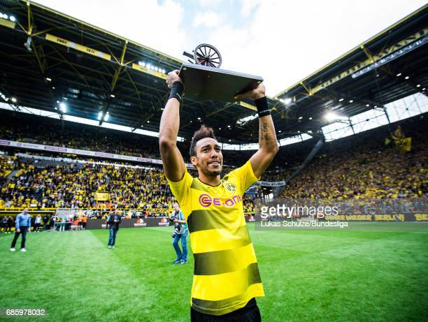 PierreEmerick Aubameyang holds his trophy for the best scorer of the season after the Bundesliga match between Borussia Dortmund and Werder Bremen at...
