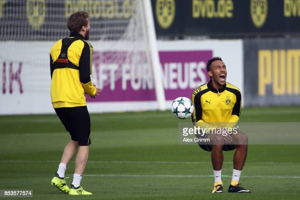 PierreEmerick Aubameyang is hit by team mate Andre Schuerrle during a Borussia Dortmund training session ahead of their UEFA Champions League Group H...