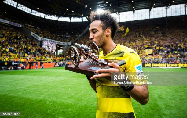 PierreEmerick Aubameyang kisses his trophy for the best scorer of the season after the Bundesliga match between Borussia Dortmund and Werder Bremen...