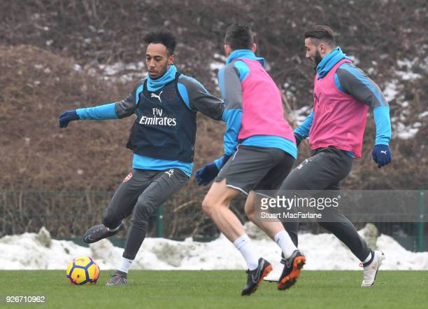 PierreEmerick Aubameyang Laurent Koscielny and Sead Kolasinac of Arsenal during a training session at London Colney on March 3 2018 in St Albans...