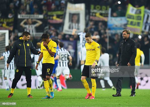 PierreEmerick Aubameyang Marco Reus and Jurgen Klopp manager of Borussia Dortmund look dejected after defeat during the UEFA Champions League Round...
