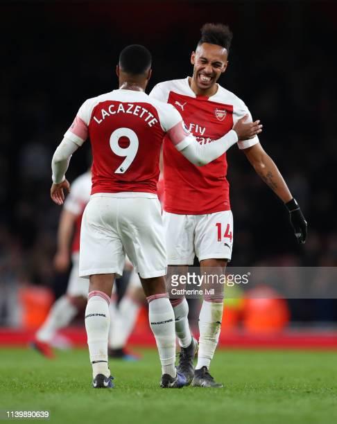 PierreEmerick Aubameyang of Arsenal an Alexandre Lacazette of Arsenal celebrate after the Premier League match between Arsenal FC and Newcastle...