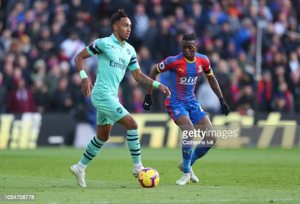 PierreEmerick Aubameyang of Arsenal and Aaron WanBissaka of Crystal Palace during the Premier League match between Crystal Palace and Arsenal FC at...