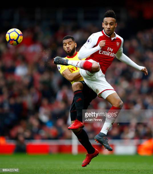 Pierre-Emerick Aubameyang of Arsenal and Adrian Mariappa of Watford in action during the Premier League match between Arsenal and Watford at Emirates...