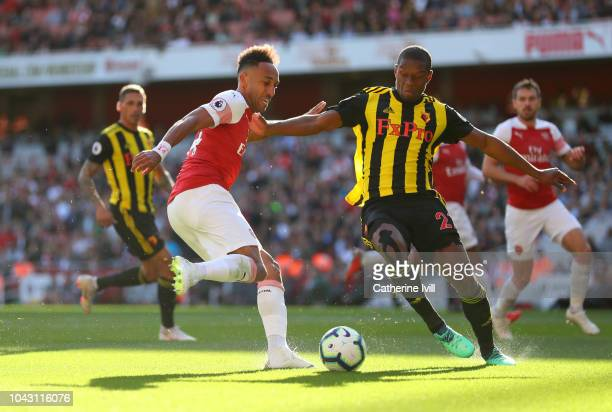 PierreEmerick Aubameyang of Arsenal and Christian Kabasele of Watford during the Premier League match between Arsenal FC and Watford FC at Emirates...