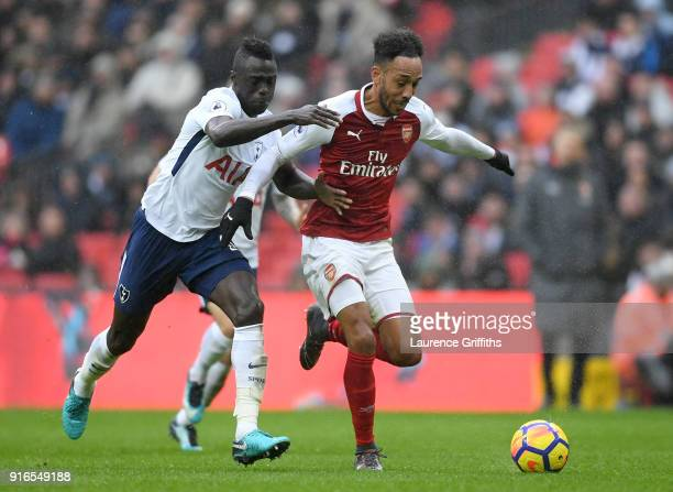 PierreEmerick Aubameyang of Arsenal and Davinson Sanchez of Tottenham Hotspur battle for the ball during the Premier League match between Tottenham...