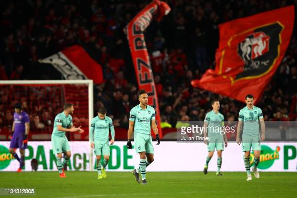 Pierre-Emerick Aubameyang of Arsenal and his team-mates show their dejection after conceding a second goal during the UEFA Europa League Round of 16...
