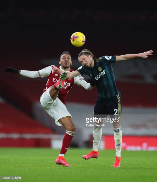 Pierre-Emerick Aubameyang of Arsenal and Luke Ayling of Leeds United battle for the ball during the Premier League match between Arsenal and Leeds...