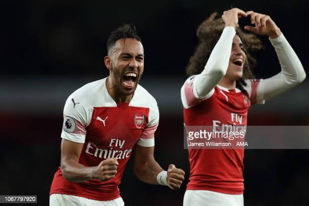 PierreEmerick Aubameyang of Arsenal and Matteo Guendouzi of Arsenal celebrate their 42 victory over Tottenham at full time of the Premier League...