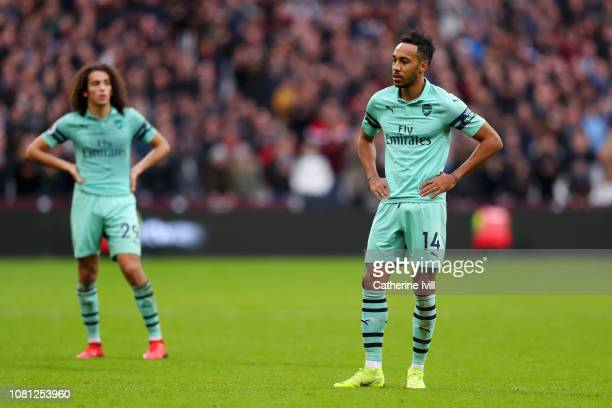 PierreEmerick Aubameyang of Arsenal and Matteo Guendouzi of Arsenal look dejected during the Premier League match between West Ham United and Arsenal...