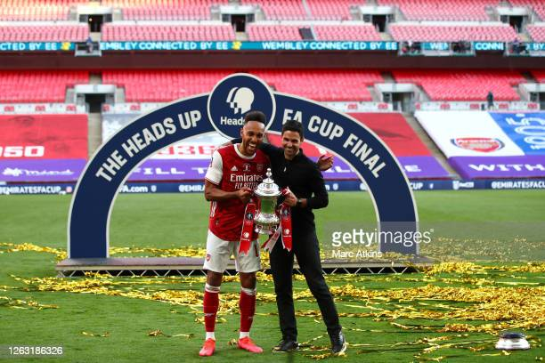 Pierre-Emerick Aubameyang of Arsenal and Mikel Arteta, Manager of Arsenal celebrate with the Heads Up Emirates FA Cup Trophy following their team's...