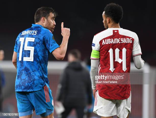 Pierre-Emerick Aubameyang of Arsenal and Sokratis Papastathopoulos of Olympiacos after the UEFA Europa League Round of 16 Second Leg match between...