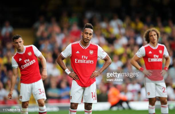 PierreEmerick Aubameyang of Arsenal and team mates Granit Xhaka and David Luiz react during the Premier League match between Watford FC and Arsenal...