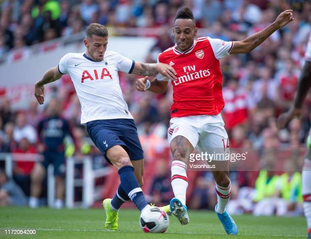 PierreEmerick Aubameyang of Arsenal and Toby Alderweireld of Tottenham Hotspur during the Premier League match between Arsenal FC and Tottenham...