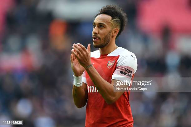 PierreEmerick Aubameyang of Arsenal applauds fans after the Premier League match between Tottenham Hotspur and Arsenal FC at Wembley Stadium on March...