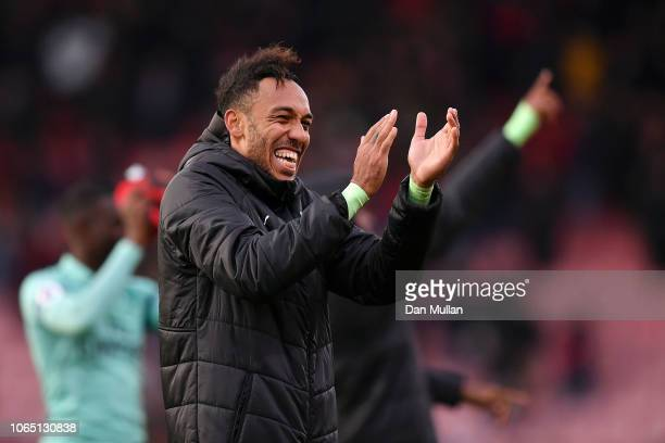 PierreEmerick Aubameyang of Arsenal applauds fans following victory in the Premier League match between AFC Bournemouth and Arsenal FC at Vitality...