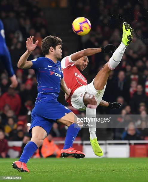 PierreEmerick Aubameyang of Arsenal attemps an overhead kick under pressure from Marcos Alonso of Chelsea during the Premier League match between...