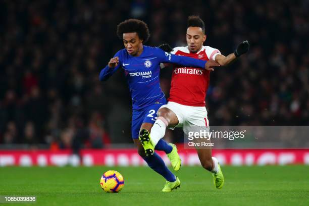 PierreEmerick Aubameyang of Arsenal battles for possesion with Willian of Chelsea during the Premier League match between Arsenal FC and Chelsea FC...