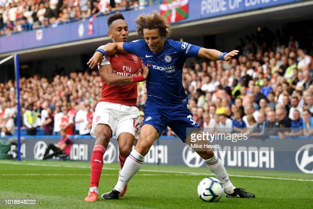 PierreEmerick Aubameyang of Arsenal battles for possession with David Luiz of Chelsea during the Premier League match between Chelsea FC and Arsenal...