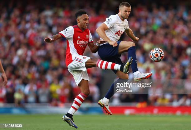 Pierre-Emerick Aubameyang of Arsenal battles for possession with Eric Dier of Tottenham Hotspur during the Premier League match between Arsenal and...