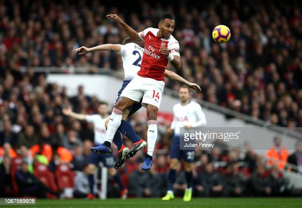 PierreEmerick Aubameyang of Arsenal battles for possession with Juan Foyth of Tottenham Hotspur during the Premier League match between Arsenal FC...
