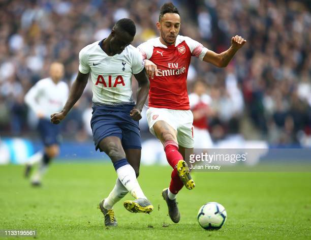 PierreEmerick Aubameyang of Arsenal battles with Davinson Sanchez of Spurs during the Premier League match between Tottenham Hotspur and Arsenal FC...