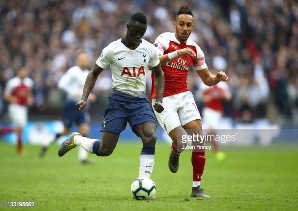 PierreEmerick Aubameyang of Arsenal battles with Davinson Sanchez of Spurs during the Premier League match between Tottenham Hotspur and Arsenal FC...