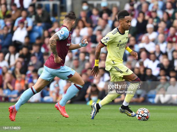 Pierre-Emerick Aubameyang of Arsenal breaks past Josh Brownhill of Burnley during the Premier League match between Burnley and Arsenal at Turf Moor...