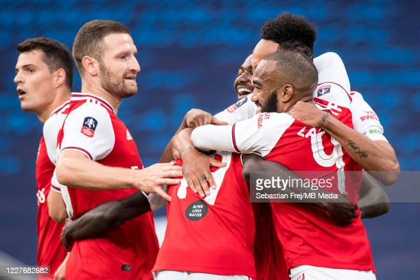 PierreEmerick Aubameyang of Arsenal celebrate with his teammates Nicolas Pepe Shkodran Mustafi Granit Xhaka Alexandre Lacazette after scoring 1st...