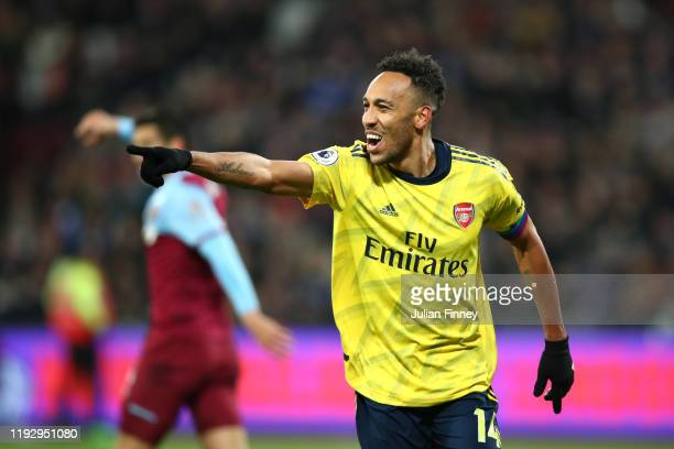 PierreEmerick Aubameyang of Arsenal celebrates after he scores his sides third goal during the Premier League match between West Ham United and...