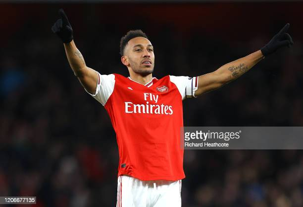 PierreEmerick Aubameyang of Arsenal celebrates after he scores his sides first goal during the Premier League match between Arsenal FC and Newcastle...