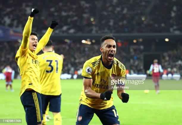 PierreEmerick Aubameyang of Arsenal celebrates after scores his sides third goal during the Premier League match between West Ham United and Arsenal...