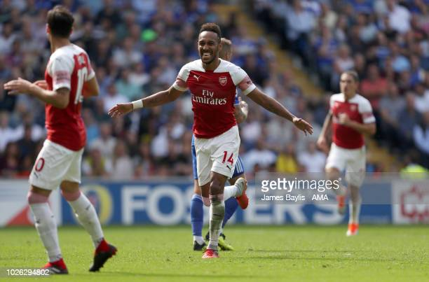PierreEmerick Aubameyang of Arsenal celebrates after scoring a goal to make it 12 during the Premier League match between Cardiff City and Arsenal FC...