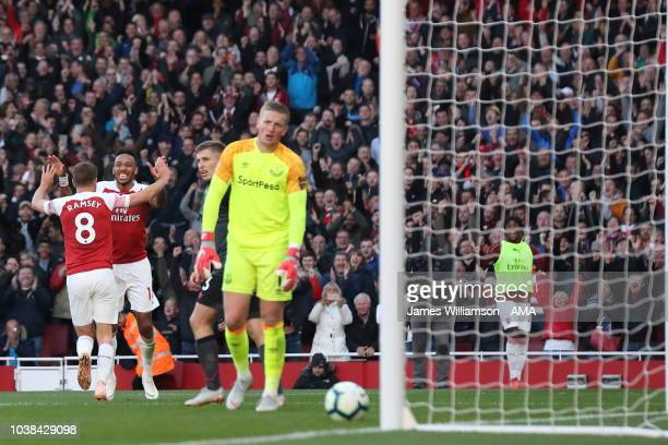 PierreEmerick Aubameyang of Arsenal celebrates after scoring a goal to make it 20 during the Premier League match between Arsenal FC and Everton FC...
