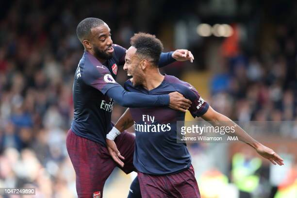 PierreEmerick Aubameyang of Arsenal celebrates after scoring a goal to make it 41 with Alexandre Lacazette of Arsenal during the Premier League match...