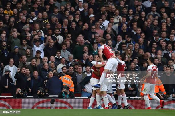 PierreEmerick Aubameyang of Arsenal celebrates after scoring a goal to make it 10 during the Premier League match between Arsenal FC and Tottenham...
