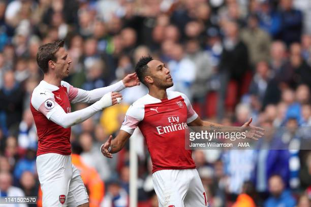 PierreEmerick Aubameyang of Arsenal celebrates after scoring a goal to make it 10 during the Premier League match between Arsenal FC and Brighton...