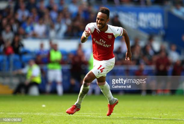 PierreEmerick Aubameyang of Arsenal celebrates after scoring his team's second goal during the Premier League match between Cardiff City and Arsenal...