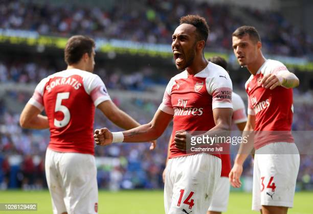PierreEmerick Aubameyang of Arsenal celebrates after scoring his team's second goal with team mates during the Premier League match between Cardiff...