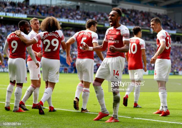Pierre-Emerick Aubameyang of Arsenal celebrates after scoring his team's second goal with team mates during the Premier League match between Cardiff...
