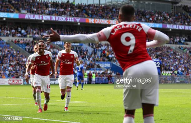 PierreEmerick Aubameyang of Arsenal celebrates after scoring his teams second goal by running to Alexandre Lacazette of Arsenal during the Premier...